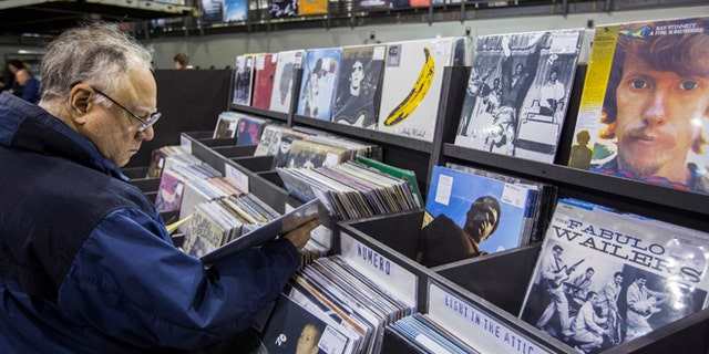 Nov. 25, 2013: A man peruses albums displayed inside of the record store Rough Trade in the Williamsburg neighborhood of Brooklyn.