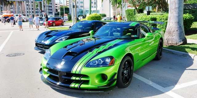 West Palm Beach, USA - January 12, 2014: A Dodge Viper sports car is parked on a city street during a large car show in downtown West Palm Beach. The car show was on public city streets with free access to the public. Pedestrians are visible in the background.