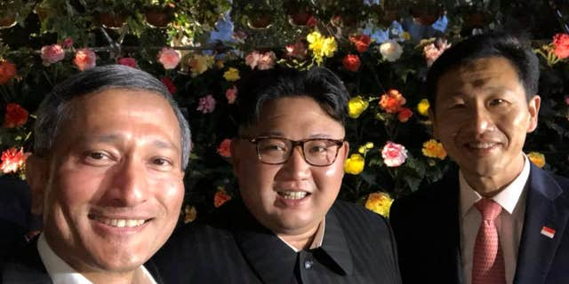 Kim Jong Un poses for a selfie with Singapore Foreign Minister Vivian Balakrishnan and Education Minister Ong Ye Kung.
