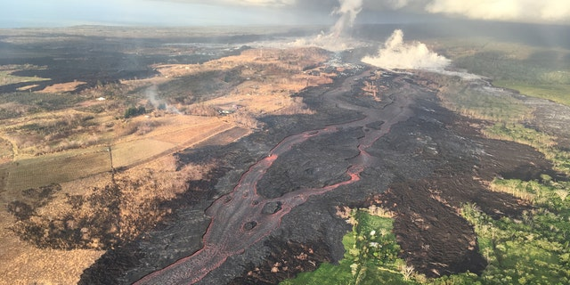 The difference in landscapes on the northern and southern sides of the fissure 8 lava channel can be seen in this aerial photo.