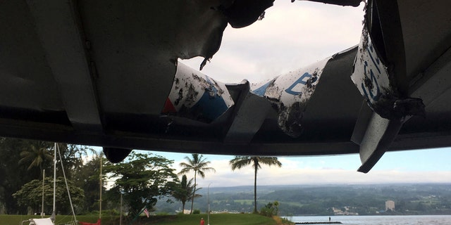This photo provided by the Hawaii Department of Land and Natural Resources shows damage to the roof of a tour boat after an explosion sent lava flying through the roof off the Big Island of Hawaii.