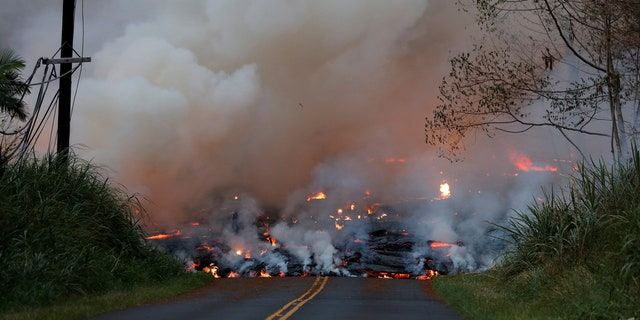A lava flow advances down Leilani Street close to Nohea Street, in the Leilani Estates near Pahoa, Hawaii, U.S., May 27, 2018.