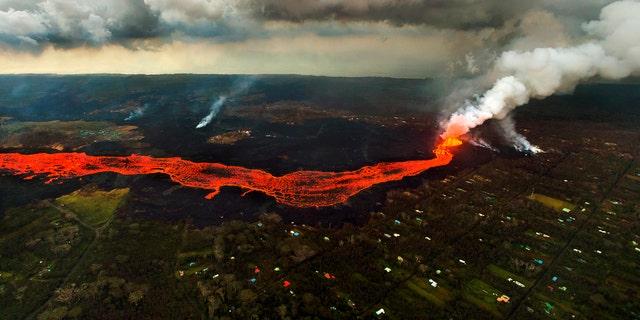 Lava from the Kilauea volcano flows in and around Pahoa, Hawaii, Sunday, June 10, 2018.