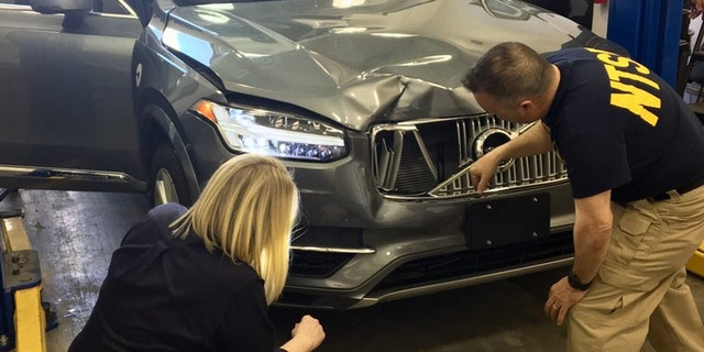 NTSB investigators examined the Uber SUV that crashed into a woman in Arizona on Sunday, killing her.