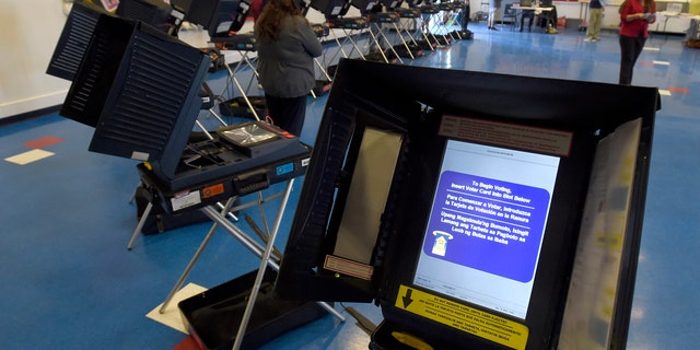 Georgia's top election official, Secretary of State Brian Kemp, also a Republican, said the electronic voting machines currently in use in Georgia are accurate and efficient and replacing them with paper would be a step backward.