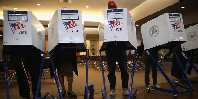 NEW YORK, NY - NOVEMBER 05:  Voters fill out their ballots at a polling station on November 5, 2013 in the Brooklyn borough of New York City. New Yorkers went to the polls to choose between Democratic candidate Bill de Blasio and Republican Joe Lhota. De Blasio was widely considered the favorite going into election day.  (Photo by John Moore/Getty Images)