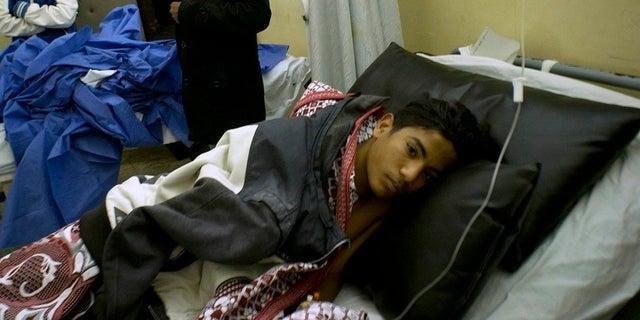 Abdallah Abdel Nasser, 14, receives medical treatment at Suez Canal University hospital in Ismailia, Egypt