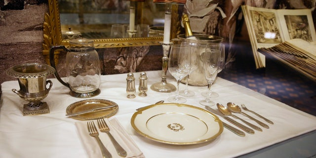 A place setting is displayed behind glass in the small museum off the lobby of the Waldorf Astoria.