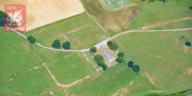Parchmarks of Roman buildings showing at Caerhun Roman fort in Wales' Conwy Valley (Crown Copyright RCAHMW)