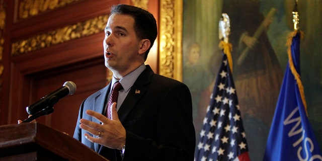 Nov. 14, 2013: Wisconsin Gov. Scott Walker speaks at the state Capitol in Madison, Wis.