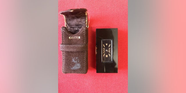 The onyx Cartier watch (Henry Aldridge & Son)