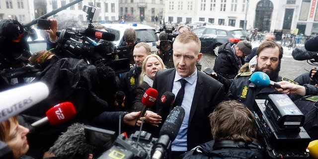 Prosecutor Jakob Buch-Jepsen, centre, arrives at the courthouse where the trial of Danish inventor Peter Madsen, charged with murdering and dismembering Swedish journalist Kim Wall aboard his homemade submarine begins, in Copenhagen, Thursday, March 8, 2018.