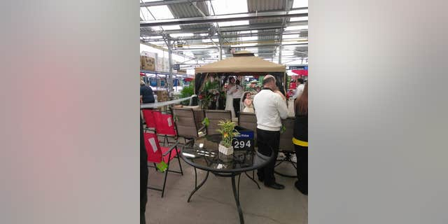 Walmart employees Leida Torres and Chrissy Slonaker exchanged vows in the garden section of the major retailer during store hours Saturday.