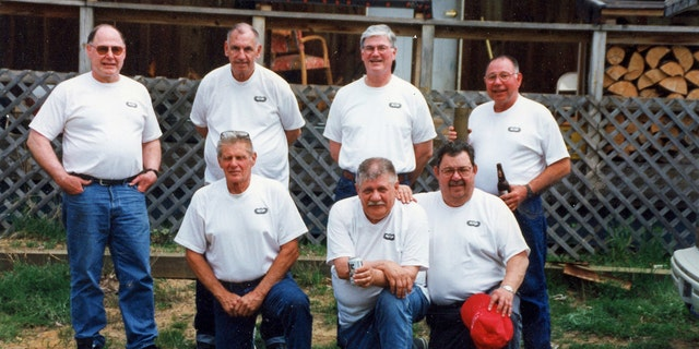 A photo of the Michigan Parachute Team reunion in 2000. Bottom row (L to R): Carl Laurin, Walt Reca, Willard; Top row (L to R): Hank Lussier, Bill Parker, Mike Lussier and Art Lussier.