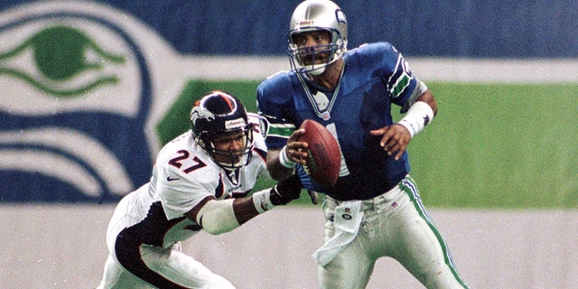 Moon played for four NFL teams in 17 seasons.  He is seen here playing for the Seattle Seahawks in 1998.