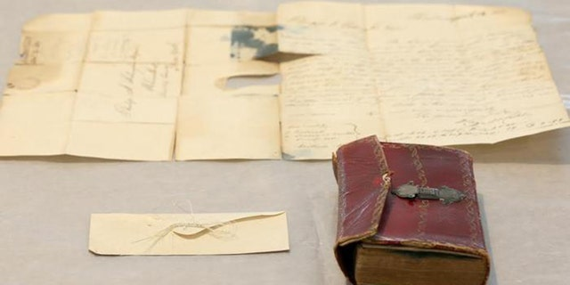 """Strands of George Washington's hair were discovered in an envelope tucked inside a leather book, """"Gaines Universal Register or American and British Kalendar for the year 1793."""""""