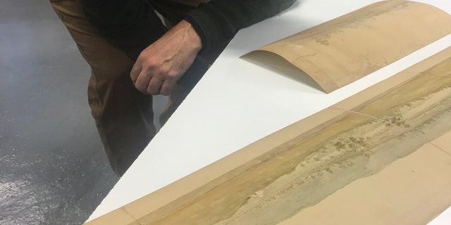 Scott Stephenson examines the watercolor (Courtesy of the Museum of the American Revolution)
