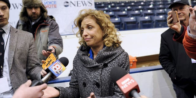 Democratic National Committee chair Debbie Wasserman Schultz talks with members of the media before the Democratic presidential candidates debate at Saint Anselm College in Manchester, New Hampshire, December 19, 2015.  REUTERS/Gretchen Ertl - RTX1ZF3K