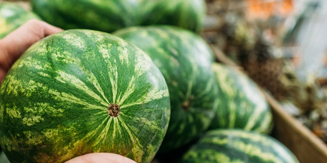 Video of a little boy trying to lift a watermelon has gone viral.