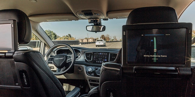 This Sunday, Oct. 29, 2017, photo provided by Waymo shows a Chrysler Pacifica minivan that are equipped with Waymo's self-driving car technology, being tested at Waymo's facility in Atwater, Calif. Waymo, hatched from a Google project started eight years ago, showed off its progress Monday during a rare peek at a closely guarded testing facility located 120 miles southeast of San Francisco where its robots complete their equivalent to driver's education. (Julia Wang/Waymo via AP)