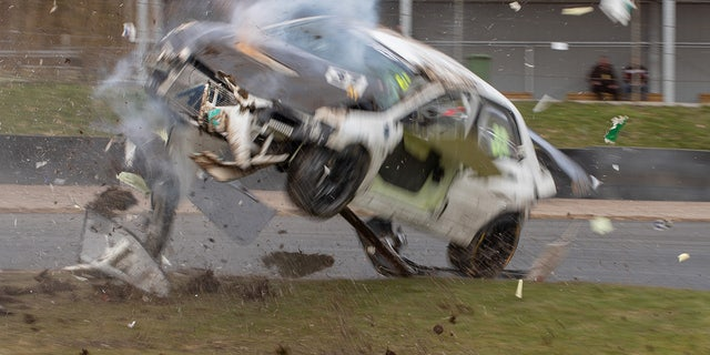 The front brakes on the race-prepared Mitsubishi EVO failed and the car went off course.