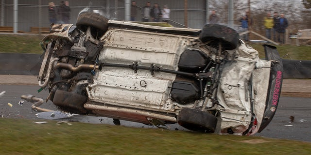 A roll cage protected the driver during the barrel-roll.