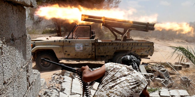 Libyan forces allied with the U.N.-backed government fire weapons during a battle with ISIS fighters in Sirte, Libya, July 21, 2016.