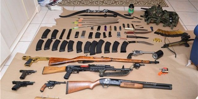 Authorities say these weapons and other lethal items were found in the home of Randall Drake in Dunedin, Florida.