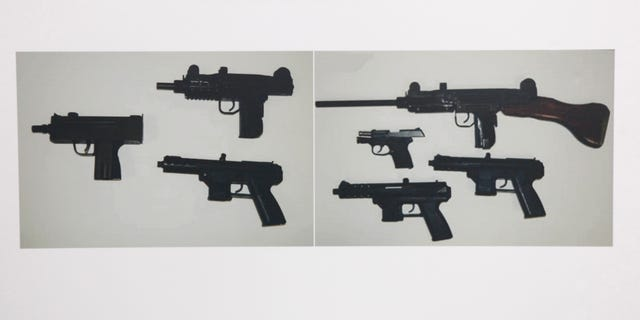 June 1, 2012: Photographs showing some of guns confiscated during the investigation of alleged illegal gun sales by two Sacramento County Sheriff's deputies are seen at a news conference in Sacramento, Calif.