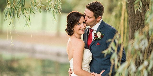 Brittany and Clayton Cook were being photographed after their wedding when Clayton noticed a boy in the water struggling to swim