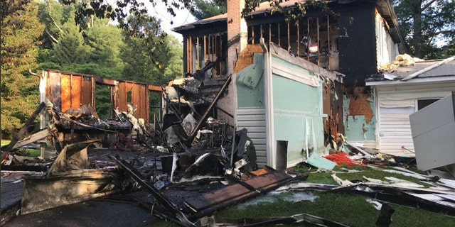 Matthew Denakis tells Fox News his in-laws' garage burned down, as did one side of the home. The roof had also collapsed on the hallway and some of the rooms.