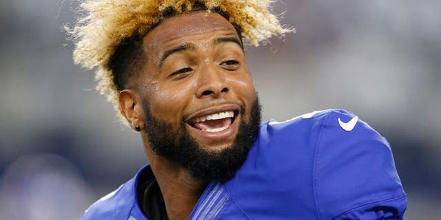 Sep 13, 2015; Arlington, TX, USA; New York Giants wide receiver Odell Beckham (13) smiles on the field prior to the game against the Dallas Cowboys at AT&T Stadium. Mandatory Credit: Tim Heitman-USA TODAY Sports