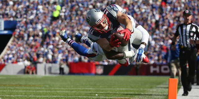 ORCHARD PARK, NY - SEPTEMBER 20: Julian Edelman #11 of the New England Patriots scores a touchdown during NFL game action as Aaron Williams #23 of the Buffalo Bills tries to make the tackle at Ralph Wilson Stadium on September 20, 2015 in Orchard Park, New York. (Photo by Tom Szczerbowski/Getty Images)