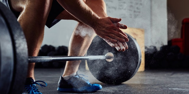 The British fitness coach and personal trainer says he can squat roughly 396 pounds.