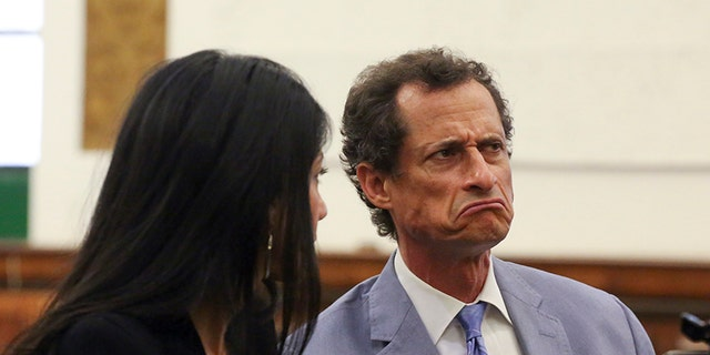 Anthony Weiner, right, and Huma Abedin appear in a New York court on Sept. 13.