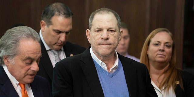Harvey Weinstein, center, listens during a court proceeding in New York during his arraignment on rape and other charges on May 25.