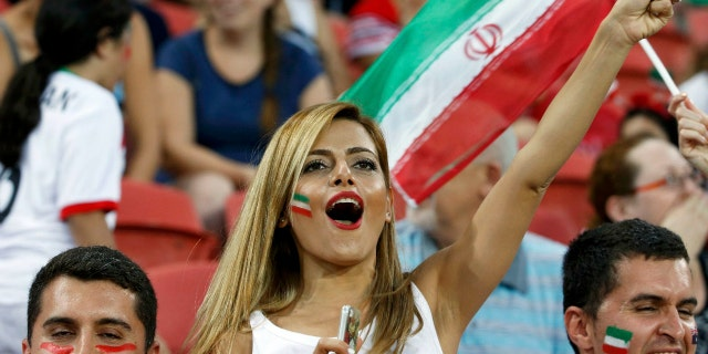 An Iran fan cheers before the start of their Asian Cup Group C soccer match against UAE at the Brisbane Stadium in Brisbane January 19, 2015.   REUTERS/Edgar Su (AUSTRALIA  - Tags: SOCCER SPORT)