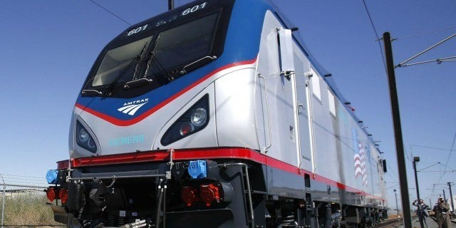 A Massachusetts woman killed by an Amtrak train on Monday reportedly saved her granddaughter's life before being struck.