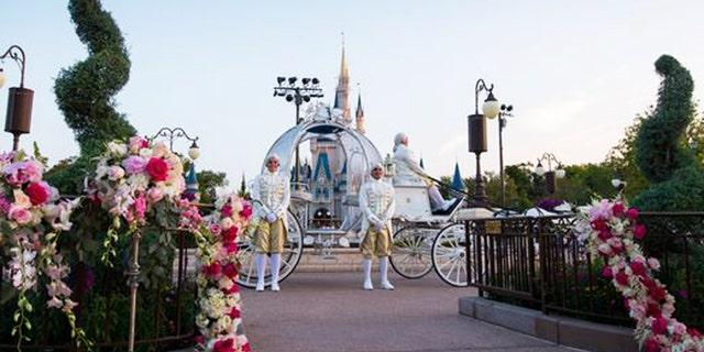 Footmen greet brides and grooms in a stunning horse-drawn carriage.