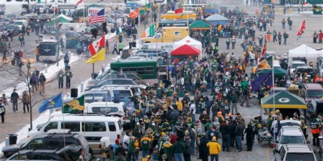 Fans tailgate at Lambeau Field before an NFL wild card playoff football game between the Green Bay Packers and the Minnesota Vikings Saturday, Jan. 5, 2013, in Green Bay, Wis. (AP Photo/Mike Roemer)