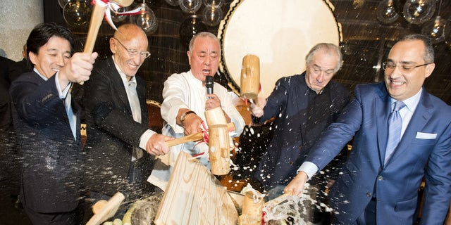 A traditional sake ceremony at the opening of De Niro's new Nobu restaurant.