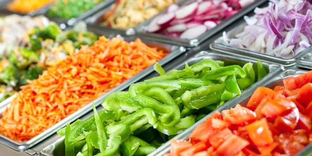 Selective-focus image of a fresh salad bar.