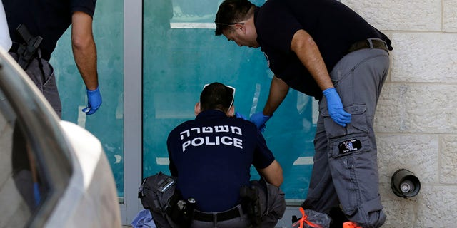 Israeli police investigating the scene where Ari Fuld was stabbed Sunday.