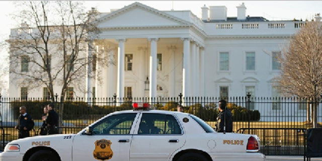 March 12, 2015: Members of the U.S. Secret Service keep watch at the fence surrounding the White House in Washington.