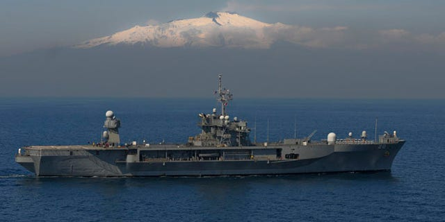 Mar. 25, 2011: U.S. Sixth Fleet's flagship USS Mount Whitney (LCC/JCC 20) steams by Mount Etna in support of Joint Task Force (JTF) Odyssey Dawn in the Mediterranean Sea.
