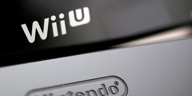 File photo - Logos are seen on Nintendo Co's Wii U game console (bottom) and its controller at the company headquarters in Kyoto, western Japan Jan. 7, 2013. (REUTERS/Yuriko Nakao)
