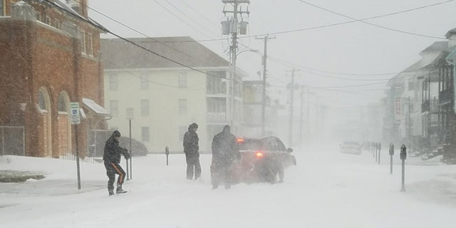 "Heavy snow and wind from a ""bomb cyclone"" is pictured."