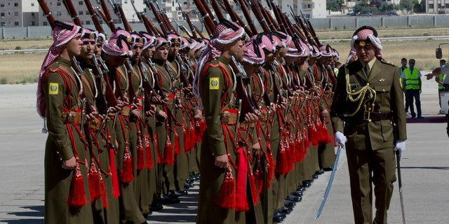 A Jordanian army officer inspects the honor guard in preparation for Prince William's arrival at Marka Airport on Sunday.