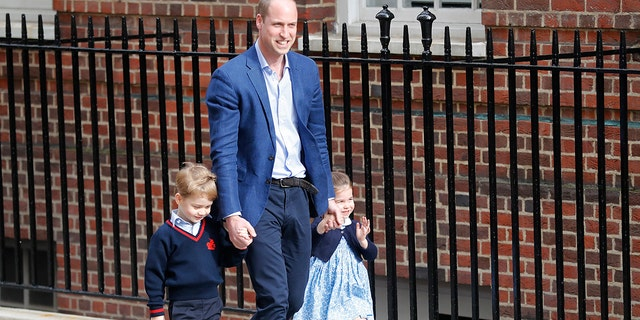 Britain's Prince William arrives with Prince George and Princess Charlotte back to the Lindo wing at St Mary's Hospital in London London, Monday, April 23, 2018.