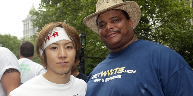"""Takeru Kobayashi (L), current world hot dog eating champion from Japan,and former Chicago Bear's football player William """"The Refrigerator""""Perry before the official weigh-in for the 88th annual Nathan's FamousFourth of July International Hot Dog Eating Contest at New York's CityHall July 3, 2003. Last year, Kobayashi doubled the world record in hotdog eating by downing 50 1/2 hot dogs and buns in 12 minutes.REUTERS/Shannon StapletonSS - RTR4IN"""